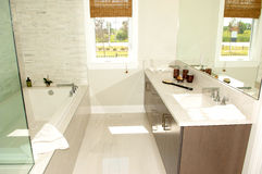 Bright bathroom in a new house with bath stab. Royalty Free Stock Photo