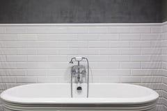 Bright bathroom with new tiles. Chrome shower, faucet, white bathroom. Bright bathroom with new tiles. Chrome shower, faucet, white bathroom Royalty Free Stock Photos