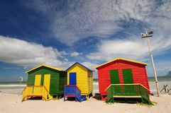 Bright Beach. Bright coloured bathing boxes on Muizenberg shoreline near Cape town Royalty Free Stock Images