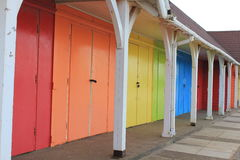 Bright beach huts Stock Photos