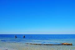 Bright Beach Side. Beach side with blue sky, ocean and horizon Stock Photos