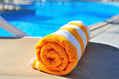 Bright beach towel on the background of the pool Royalty Free Stock Photo