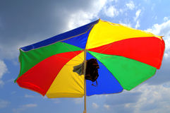 Bright beach umbrella Stock Images