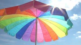 Bright beach umbrella and sun stock video footage