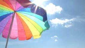 Bright beach umbrella and sun stock video
