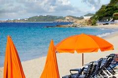 Bright beach umbrellas Stock Images
