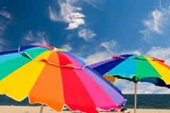 Bright beach umbrellas. On the beach Royalty Free Stock Photo