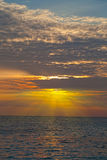 Bright beams of a rising sun. Over the sea, Thailand Royalty Free Stock Images