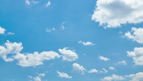 Bright beautiful blue sky with clouds for background or texture stock footage