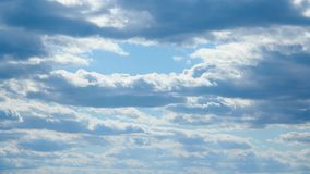 Bright beautiful blue sky with clouds for background or texture stock video footage
