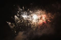 Bright beautiful colorful fireworks. Colored lights in the night sky stock image