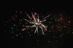Bright beautiful colorful fireworks. Colored lights in the night sky stock photography