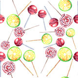Bright beautiful colorful wonderful delicious tasty yummy summer fresh dessert lemon twisted caramel candies on a sticks located r Stock Photography