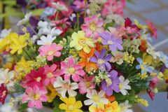 Bright and beautiful colors of plastic flowers.  royalty free stock photos