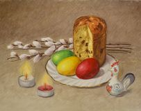 Bright beautiful composition of willow branches, Easter cake, painted eggs, statuettes of rooster and two burning candles. For stock photos