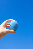 Bright Beautiful Easter egg in hand on background Royalty Free Stock Images