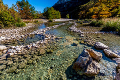 Bright Beautiful Fall Foliage on the Crystal Clear Frio River. Royalty Free Stock Photos