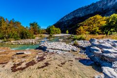 Bright Beautiful Fall Foliage on the Crystal Clear Frio River in Texas. Royalty Free Stock Image
