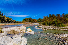 Bright Beautiful Fall Foliage on the Crystal Clear Frio River, Texas. Stock Photo