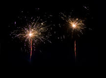 Bright beautiful fireworks at night Stock Images