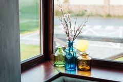Bright beautiful flowers in a vase on the window stock photo