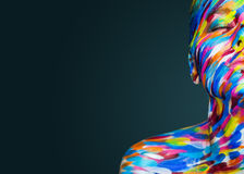 Bright beautiful girl with art colorful make-up and bodyart. Portrait of the bright beautiful emotional woman with art make-up Stock Photography