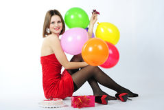 Bright beautiful girl in red gown Royalty Free Stock Images