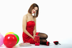 Bright beautiful girl in red gown Stock Photo