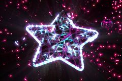 Bright beautiful glowing star on a Christmas tree in the evening. Bright beautiful glowing star close-up on a Christmas tree in the evening, holiday background stock image