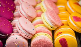 Bright beautiful macaroons with tender and flavorful cream. The contrast of colors and the ideal form, selective focus.  royalty free stock image