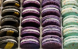Bright beautiful macaroons with tender and flavorful cream. The contrast of colors and the ideal form, selective focus.  royalty free stock photo