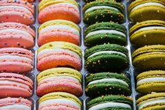 Bright beautiful macaroons with tender and flavorful cream. The contrast of colors and the ideal form, selective focus.  royalty free stock photos