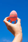 Bright Beautiful pink Easter egg in hand on Royalty Free Stock Photos