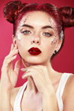 Bright beautiful readhead girl with tinsel hairstyle and art makup. Royalty Free Stock Image