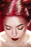 Bright beautiful readhead girl with tinsel hairstyle and art makup. Stock Image