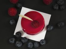 New beautiful stylish red cake with raspberries stock image