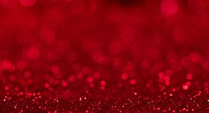 Bright beautiful sparkling red background with bokeh effect. For advertising and social media posts stock photo