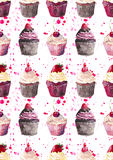 Bright beautiful tender delicious tasty chocolate yummy summer dessert cupcakes with red cherry strawberry and raspberry on red pi Stock Photos