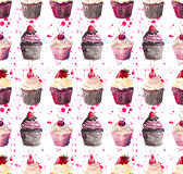 Bright beautiful tender delicious tasty chocolate yummy summer dessert cupcakes with red cherry strawberry and raspberry on red pi Royalty Free Stock Photography
