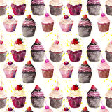 Bright beautiful tender delicious tasty chocolate yummy summer dessert cupcakes with red cherry strawberry and raspberry on yellow Royalty Free Stock Images