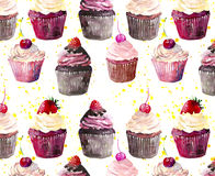 Bright beautiful tender delicious tasty chocolate yummy summer dessert cupcakes with red cherry strawberry and raspberry on yellow Stock Photos