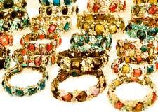 Bright and beautifully jeweled bracelets. Large gold and crystalized bracelets Royalty Free Stock Image