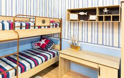 Bright bedroom with a bed and cupboard Royalty Free Stock Photography