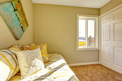 Bright bedroom with beige walls. Stock Photos