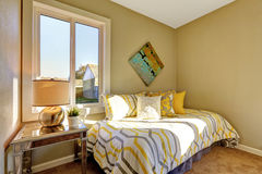 Bright bedroom with beige walls. Royalty Free Stock Images