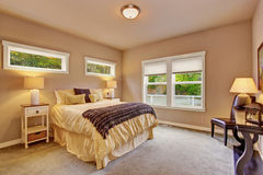 Bright bedroom with carpet and windows. Royalty Free Stock Photos