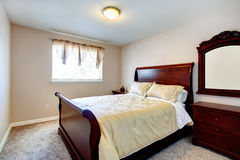 Bright bedroom with cherry wood furniture Stock Photos