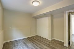 Bright beige empty room with grey hardwood floor royalty free stock images