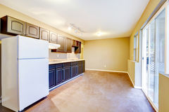 Bright beige kitchen room interior in old house. Stock Photos