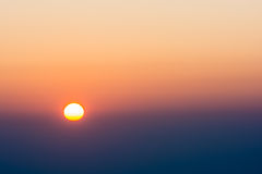 Bright big sun on the sky. With yellow orange and blue gradient colors Royalty Free Stock Photography